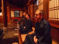 Brother Irénée (forefront) and Brother Matteo at zazen.